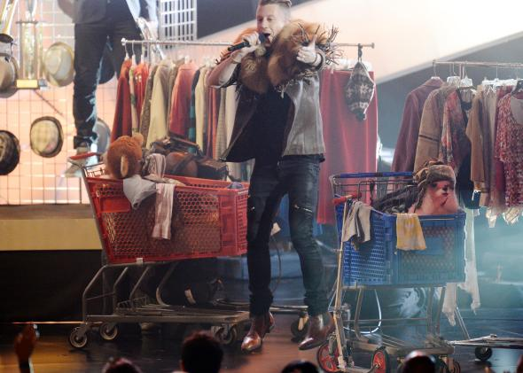 Macklemore performs during the Grammy Nominations Concert at the Nokia Theatre in Los Angeles on Dec. 6, 2013.